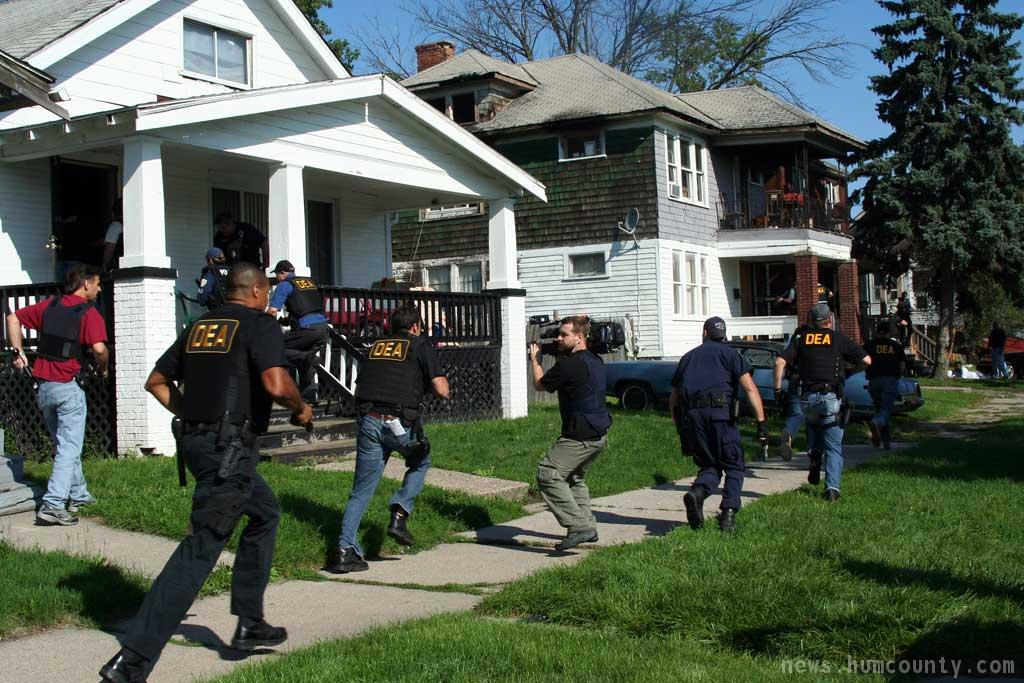 federal agents raiding a drug house