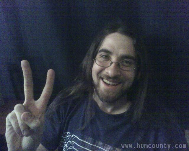 humboldt county hippie guy long hair glasses peace